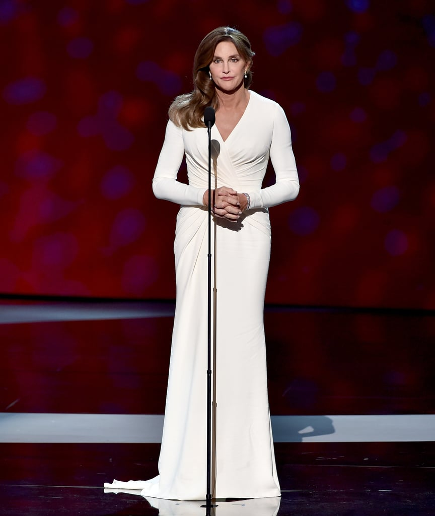 Caitlyn Jenner wore an elegant white Atelier Versace dress on stage at the ESPYs. She finished her look with Stuart Weitzman heels, a diamond bracelet, and emerald pearl-adorned earrings by Beladora.