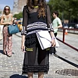Offset a sheer black Summer dress with an oversized white envelope clutch. The menswear-inspired portfolio will toughen up its more feminine complement.