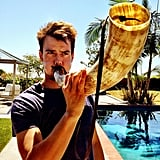Josh Duhamel got to blow the Viking horn at a Minnesota Vikings football game. Source: Twitter user joshduhamel