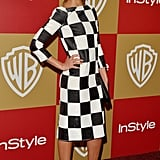 Jessica Alba opted for a black-and-white checkered Louis Vuitton midi dress and black Casadei pumps for InStyle's Golden Globe Awards afterparty in LA.