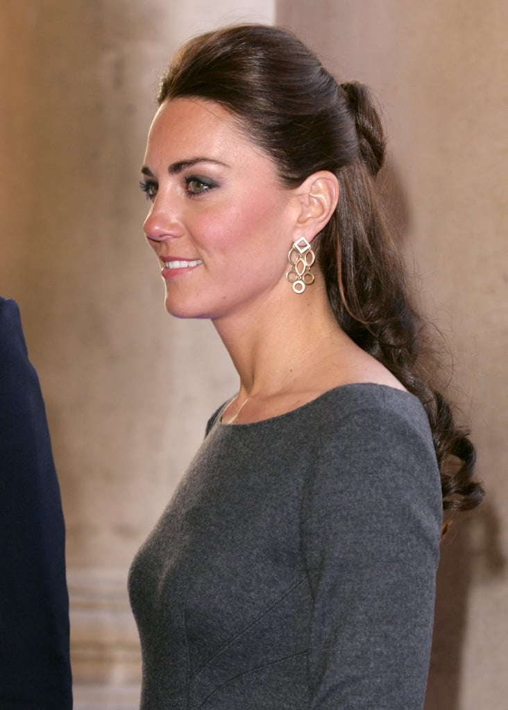 Her delicate circle link drop earrings were a girlie touch to her gray Amanda Wakeley dress.