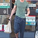 Ryan Gosling with one pant leg rolled up.