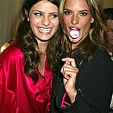Isabeli Fontana and Alessandra Ambrosio posed backstage with sweet treats in 2003.