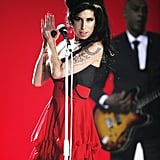 She was clad in a red frock while performing at the Brit Awards in February 2007.