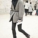 Emmanuelle Alt made her arrival in belted blazer and black denim.