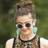 Um, how cool are her sunglasses? Not to mention the fact that her turquoise jewels pop against cool leopard print.