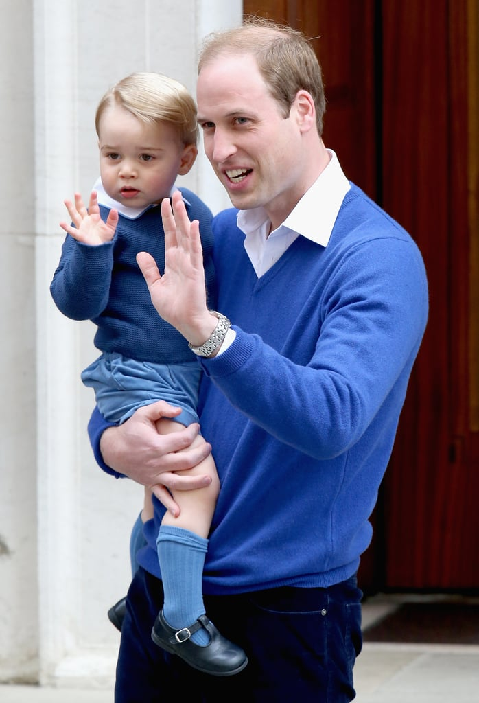"""Prince William picked up Prince George and brought him to St. Mary's hospital in London to meet his baby sister on Saturday. Just hours after the Duchess of Cambridge gave birth to her and William's second child, William left the hospital with a smile, telling photographers that he was """"just going to pick up George."""" Minutes later, William returned with George, who declined to walk himself into the Lindo Wing and instead opted to be carried in his dad's arms. The little one wore a matching outfit to his father's! It's a big day for George since he became a big brother and will be introduced to his new sibling before the family exits the hospital."""