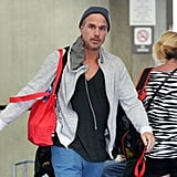 Jason Trawick wore a sweatshirt and blue pants in the Maui airport.