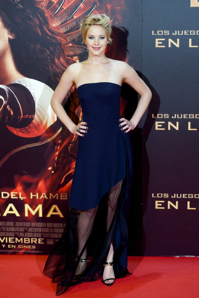 At The Hunger Games: Catching Fire's premiere in Madrid, Jennifer Lawrence opted for a midnight-blue bustier Dior gown with a sheer bottom.