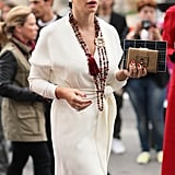 A turban injected just a little whimsy into a sophisticated, creamy white wrap dress.