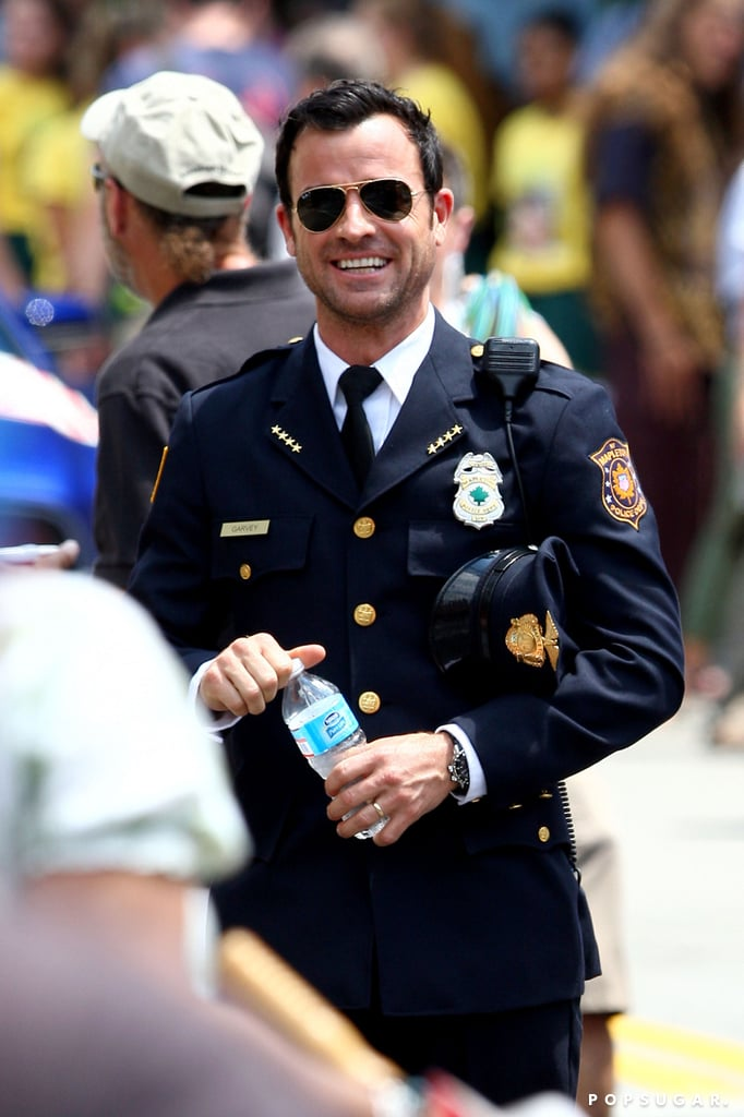 Justin Theroux wore a police uniform while filming The Leftovers in NYC today.
