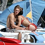 Vanessa Hudgens wore a bikini and hugged Austin Butler.