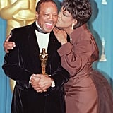 Oprah Winfrey planted one on Quincy Jones to celebrate his Jean Hersholt Humanitarian Award in 1995.