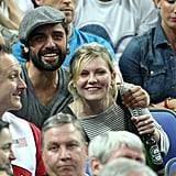 Kirsten Dunst and Oscar Issac were all smiles as they watched the  Olympic basketball tournament at the North Greenwich Arena in London.