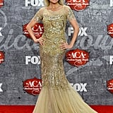 Kristin Chenoweth wore a gold gown at the American Country Awards.