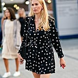 A sleek shoulder bag is the perfect touch to a polka-dot mini dress.