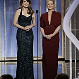On stage, Amy Poehler changed into a deep-V-front burgundy maxi dress, which provided a sexier hue to the sophisticated silhouette.