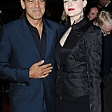 George Clooney with Evan Rachel Wood in London.