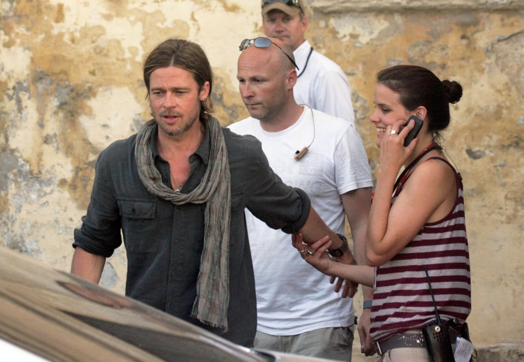 Brad Pitt linked up with a co-worker on set.