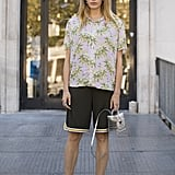 Don't be afraid to style your sneakers with gym shorts and a Hawaiian-print shirt.
