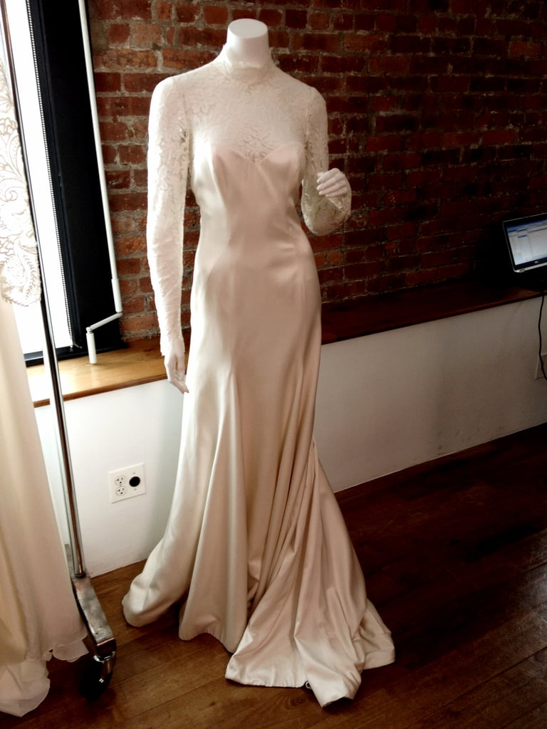 The Flora dress, as seen on a mannequin, has a pretty long-sleeved silhouette with a full chiffon skirt and open back.