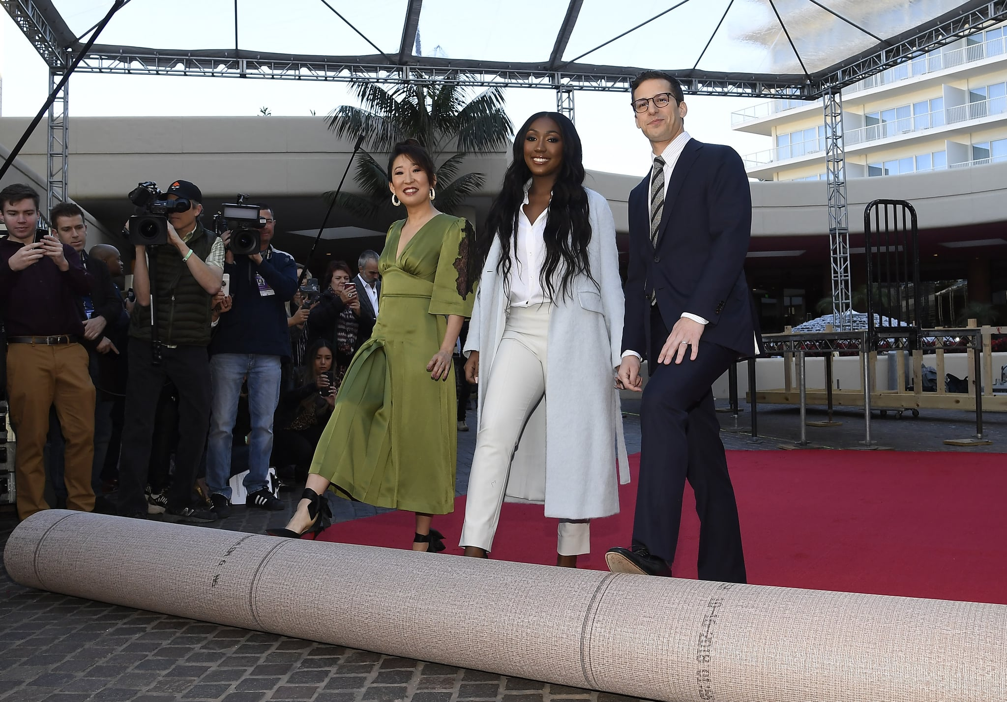 BEVERLY HILLS, CA - JANUARY 03: Sandra Oh (L) and Andy Samberg (R), hosts of the 76th Annual Golden Globe Awards, and Isan Elba (C), Golden Globe Ambassador, rollout the red carpet during a preview day at The Beverly Hilton Hotel on January 3, 2019 in Beverly Hills, California. (Photo by Kevork Djansezian/Getty Images)
