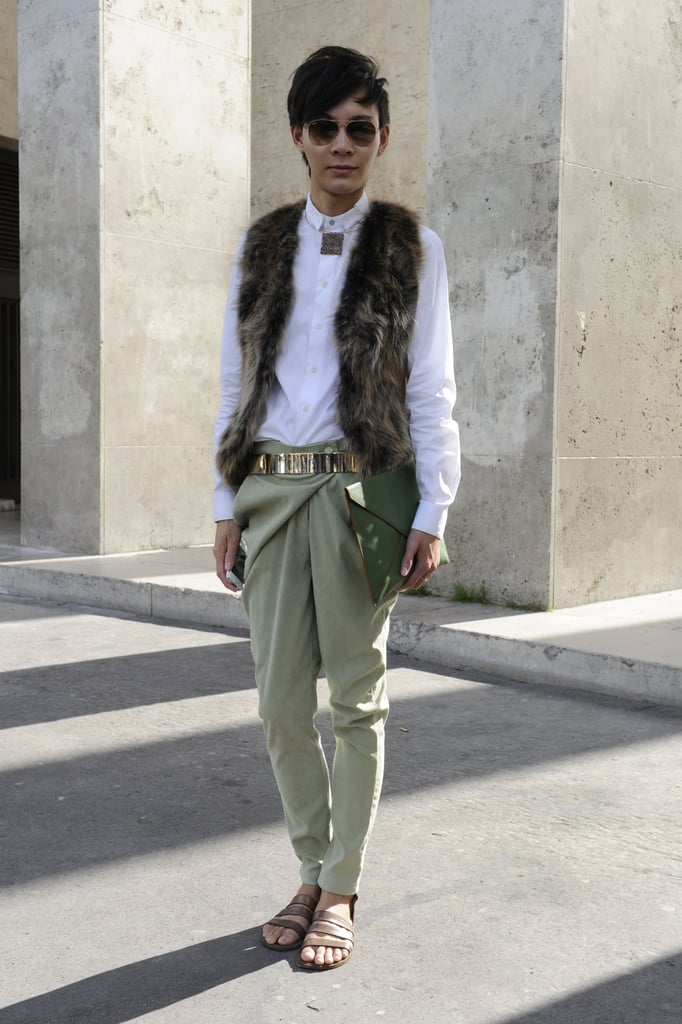 A fur vest gave these lightweight trousers and sandals a touch of Fall.