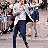 The day before his wedding to Meghan Markle, Prince Harry stepped out in a smart grey blazer to meet with members of the public who had gathered in Windsor for the celebrations.