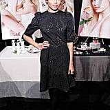 Zoe Kravitz donned a little black laser-cut dress with black tights at Jill Stuart.