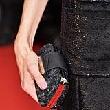 Sofia Coppola carried a black-and-silver clutch.
