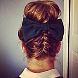 A braid, bow, and bun make for an alluring hairstyle. Source: Instagram user sarahbkthompson