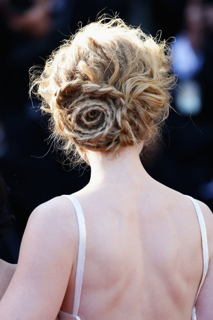 However, Nicole's chignon was far from boring. The braided style mimicked a rose.