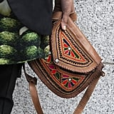 We love how this chic look was finished off with an exotic woven bag.