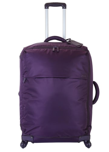 A cool pop of purple and multi-directional wheels with 360 degree rotation for smooth travel.  Lipault Paris Check-In Trolley ($230)