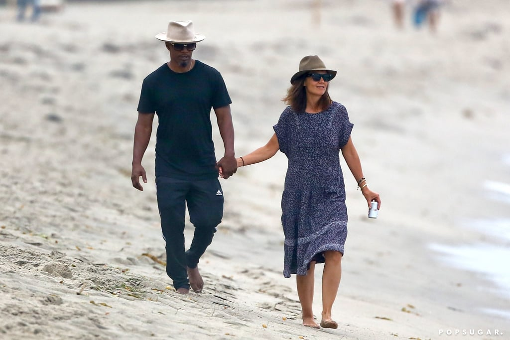 Katie Holmes and Jamie Foxx are finally coming out of their shells when it comes to their extremely private romance. The couple, who were first linked back in 2013, were photographed walking hand in hand along the beach in Malibu, CA, on Monday. The two, who have rarely been spotted together, showed sweet PDA as they shared a few laughs while taking a stroll in the sand. Jamie even filmed Katie on his phone as she playfully splashed in the water with a drink in hand. After having a little fun on the beach, the two retired to an oceanfront home and relaxed on the patio. Their relationship marks Katie's first public romance since divorcing Tom Cruise in 2012. Hopefully Jamie and Katie will make even more sweet couple appearances in the future.      Related:                                                                                                           Katie Holmes Shares an Incredibly Sweet Bond With Her Daughter, Suri Cruise