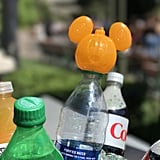 You can add Mickey drink toppers to your bottles.