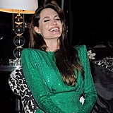 Angelina Jolie cracked herself up during the Sony after party in 2011.