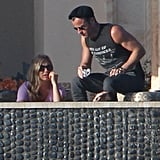 Justin Theroux wore a sleeveless shirt while he chatted with Jennifer Aniston.