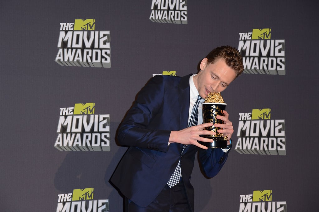 Tom tried to eat his MTV Movie Award.