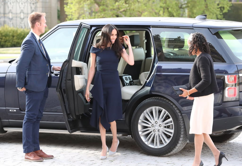 On the day before her wedding, Meghan stepped out in a dreamy off-the-shoulder Roland Mouret dress, which she wore with gray suede Manolo Blahnik pumps.