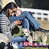 Zoe sat on the sidelines with her dog, Mugsy.