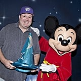 Eric Stonestreet got to hold onto Mickey Mouse's Fantasia hat when he met up with the famous mouse at the park in January 2014.
