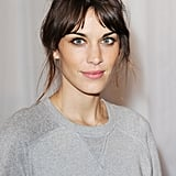 Pulling your hair up into a topknot is fast, easy, and fashionable. Take a styling cue from Alexa Chung and leave some wisps at the side for an effortless feel. To add more texture, try using a dry shampoo and then backcomb your hair before pulling it back with your hands.