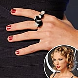 Taylor Swift kept things classic with short, red nails.