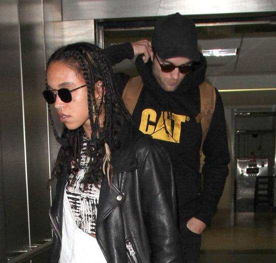 Robert Pattinson and FKA twigs not breaking as the two are photographed arriving at LAX