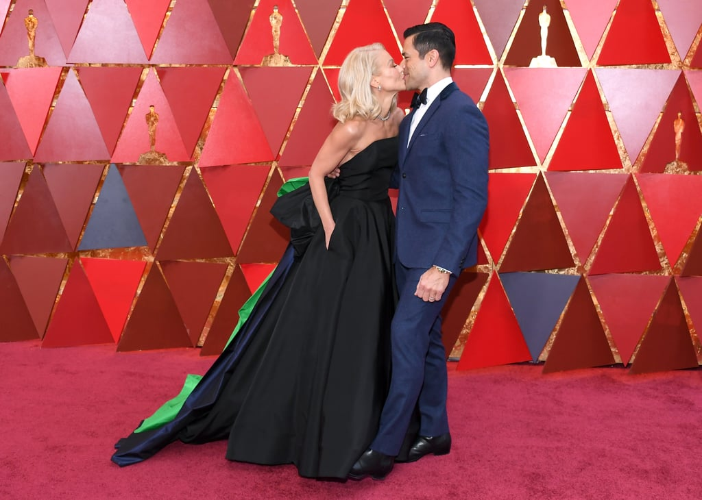 "Sunday's Oscars brought out so many cute celebrity couples, but we always have a soft spot for Kelly Ripa and Mark Consuelos. The couple, who will be celebrating their 22nd wedding anniversary in May, looked like prom queen and king as they played up their PDA on the red carpet. Kelly stunned in a strapless black ball gown, while Mark cut a suave figure in a navy tux.  Kelly grabbed headlines just last week when she defended her Live With Kelly cohost, Ryan Seacrest, following the recent sexual misconduct allegations that were made against him by former E! stylist Suzie Hardy. While discussing the Oscars on their show, Kelly told Ryan, ""I just want you to know you are a privilege to work with, and I adore you, and I am speaking on behalf of all of us here."""