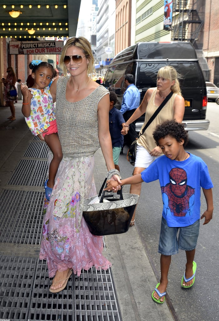 "Heidi Klum carried her daughter Lou in her arms, with kids Leni, Johan, and Henry close by, for a trip to Times Square on Saturday in NYC. The star and her little ones took in a Broadway performance of Newsies, and got to hang out backstage afterward to visit with the cast. Heidi praised the performance on Twitter, and wrote, ""Always love visiting Broadway! Amazing performance."" The model and mother of four is back in the States after a recent stint in Europe. Heidi got silly for an appearance on the Spanish television show El Hormiguero in Madrid last month, traveled to her homeland for Germany's Next Top Model finals, and swung through France for bashes at Cannes. Now, she's back to focusing on Project Runway and even welcomed special guest judge Katie Holmes to the set for a day of shooting."
