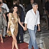 While George wore a casual button-down and jeans, Amal's fancy cocktail number played up her glow.