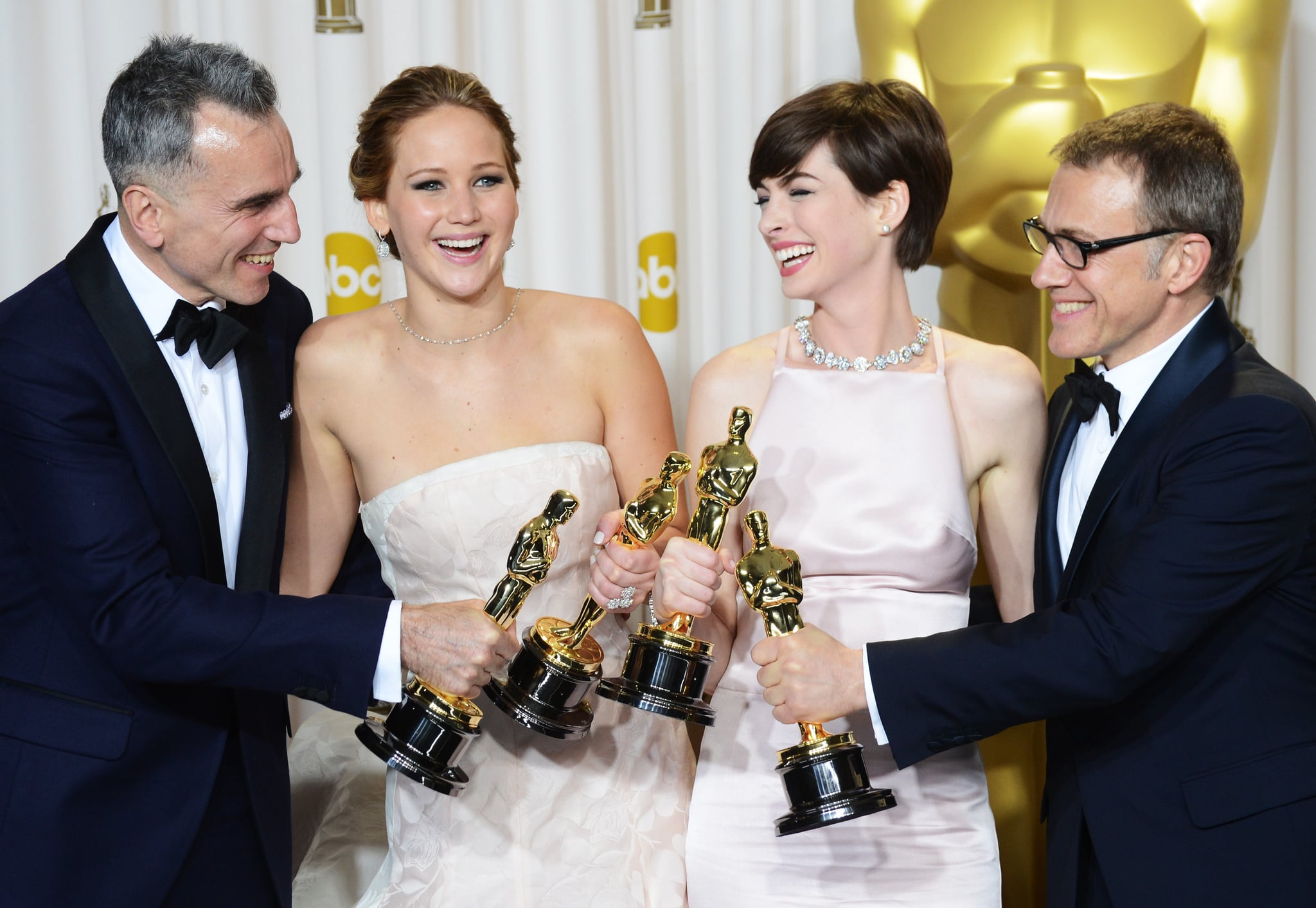 Daniel Day-Lewis, Jennifer Lawrence, Anne Hathaway, and Christoph Waltz backstage at the Oscars 2013.