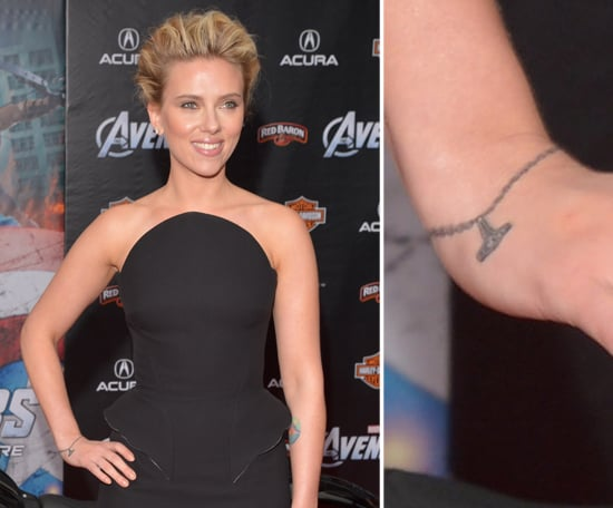 "NYC native Scarlett Johansson debuted a bracelet-esque tattoo in 2012. The ink even features a charm that reads ""I (heart) NY."""